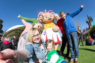 Family with Upsy Daisy character in CBeebies Land at Alton Towers Resort