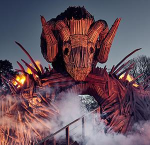 Wicker Man at night, with flames and smoke all around