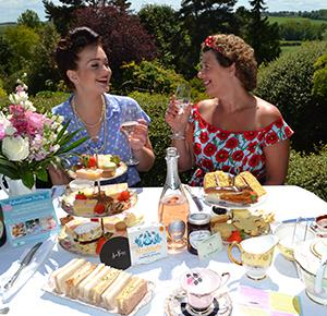 Ladies enjoy a vintage afternoon tea al fresco at Dorothy Clive Garden (landscape)