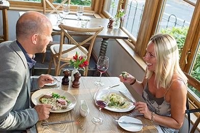 Couple enjoying a meal at The Duncombe Arms (landscape)
