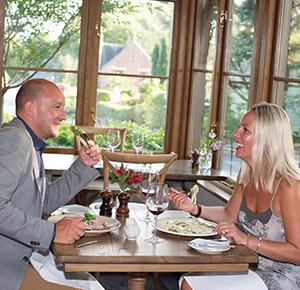 Couple enjoy a meal at The Duncombe Arms