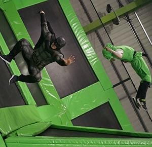 Superheroes show off their skills on the trampolines at Flip Out