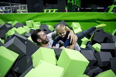 Father and son enjoying a day at Flip Out 393x261