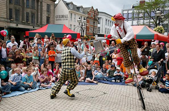 Clowns entertain the crowd in Stafford's Market Square