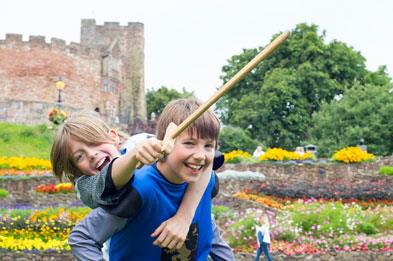 Boys role playing knights in front of Tamworth Castle