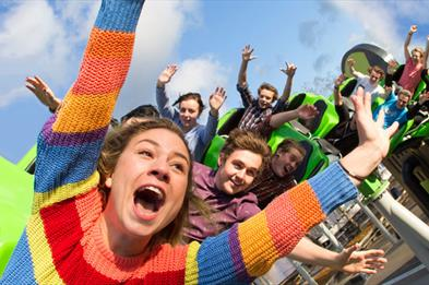 Drayton Manor Park Accelerator ride girl in front seat wearing stripy jumper
