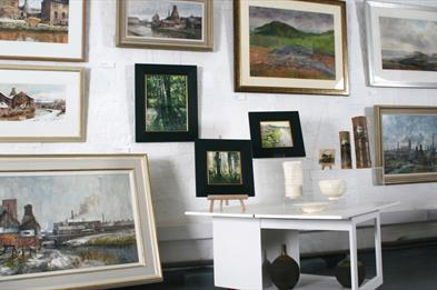 painting display wall in Barewall Gallery