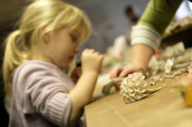 Little girl making a ceramic posy